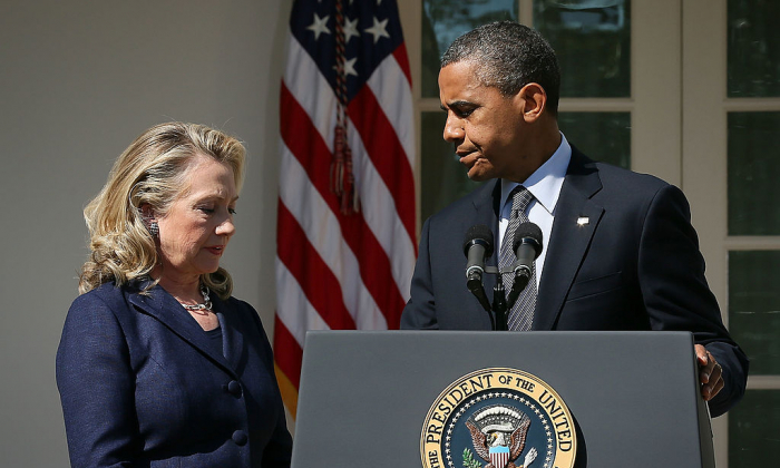 U.S. President Barack Obama (R) makes a statement in response to the attack at the U.S. Consulate in Libya as Secretary of State Hillary Clinton (L) looks at the Rose Garden of the White House in Washington on Sept. 12, 2012. (Alex Wong/Getty Images)