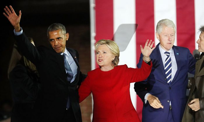 Former Secretary of State Hillary Clinton stands with former President Barack Obama during an election eve rally on Nov. 7, 2016, in Philadelphia, Pennsylvania. (Spencer Platt/Getty Images)