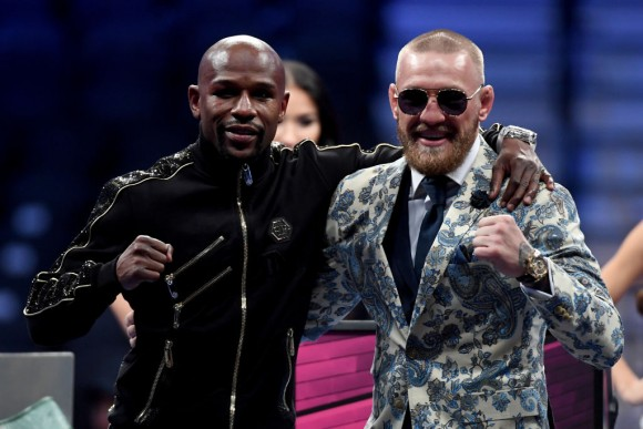 Floyd Mayweather Jr. (L) and Conor McGregor pose for pictures during a news conference after Mayweather's 10th-round TKO victory in their super welterweight boxing match on August 26, 2017 at T-Mobile Arena in Las Vegas, Nevada. (Photo by Ethan Miller/Getty Images)