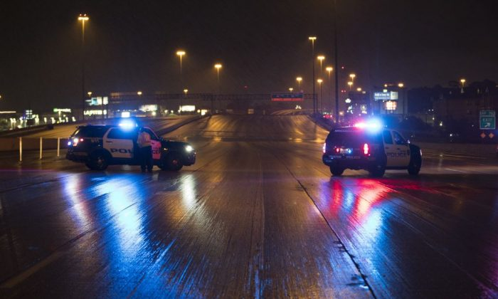 Houston Police block Interstate 10 East early Monday morning near the junction with Loop 610 due to high water from Hurricane Harvey August 28, 2017 in Houston, Texas. (Erich Schlegel/Getty Images)