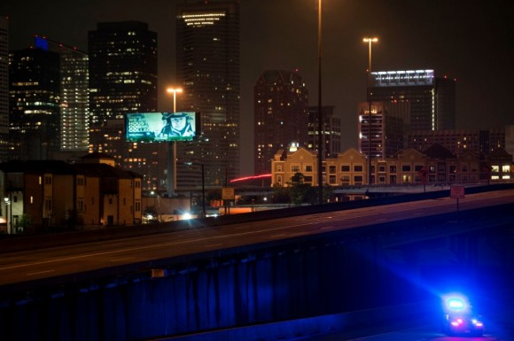 A police car is seen after the Mayor of Houston, Sylvester Turner, imposed a citywide curfew in the aftermath of Hurricane Harvey August 29, 2017 in Houston, Texas. (BRENDAN SMIALOWSKI/AFP/Getty Images)