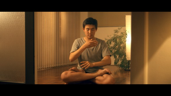 : Eric doing the Falun Gong meditation exercise at home in Sydney, Australia. China is the only country in the world that doesn't allow Falun Gong practitioners to meditate freely.  (Alexander Nilsen)