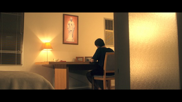 "Caption: Eric Jia in a scene from the short film ""Split by the State"", writing to Australia's Prime Minister seeking urgent help to save his father. (Alexander Nilsen)"
