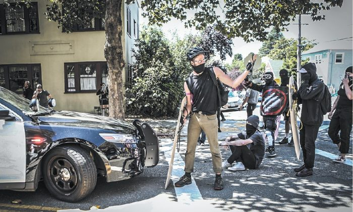 Far-left Antifa extremists prepare for a confrontation in Berkeley, Calif., on Aug. 27. The communist theory of dialectical materialism aims to incite conflict and struggle. (AMY OSBORNE/AFP/GETTY IMAGES)