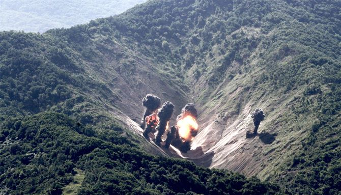 Munitions from a U.S. Air Force, U.S. Marine Corps and Republic of Korea Air Force bilateral mission explode at the Pilsung Range, South Korea.       (U.S. Air Force photo by Staff Sgt Alex Fox Echols III/Released)