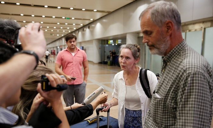 Aid workers Heidi Linton (2nd R) and Rob Robinson (R) of Christian Friends of Korea talk to the media after their arrival from Pyongyang at Beijing airport, China on Aug. 31, 2017. (REUTERS/Thomas Peter)
