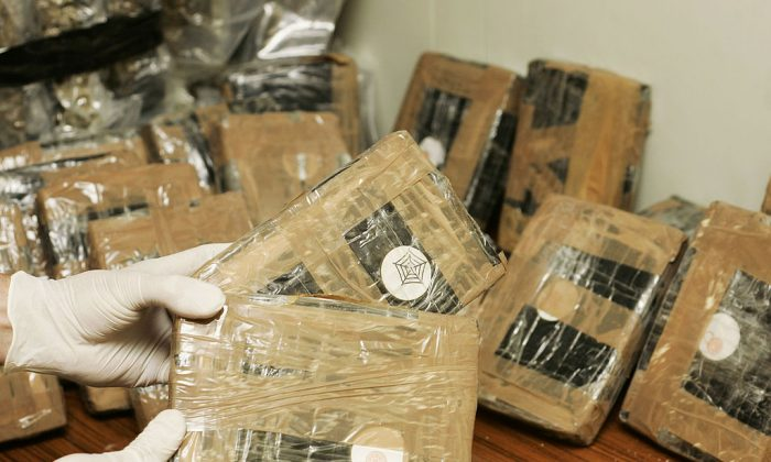Confiscated bags containing cocaine.  (Photo by Mark Renders/Getty Images)