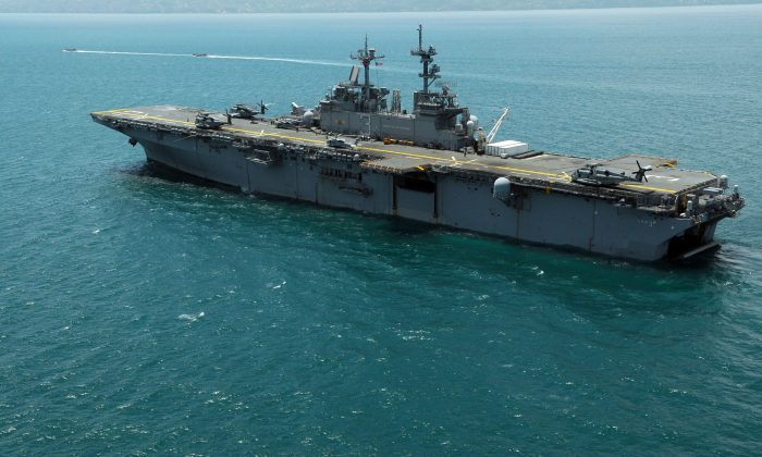 In this handout image provided by the U.S. Navy, the amphibious assault ship USS Kearsarge (LHD 3) is anchored off the coast in Port-Au-Prince, Haiti, 2008. (Joshua Adam Nuzzo/U.S. Navy via Getty Images)