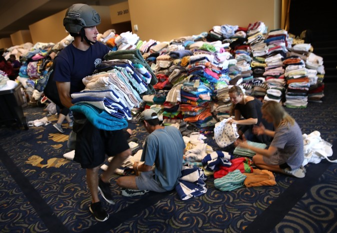 Volunteers organize donated emergency supplies at the temporary shelter at the Lakewood Church August 29, 2017 in Houston, Texas. Thousands of Houston area residents are currently residing in shelters due to flooding caused by the impact of Hurricane Harvey.  (Win McNamee/Getty Images)