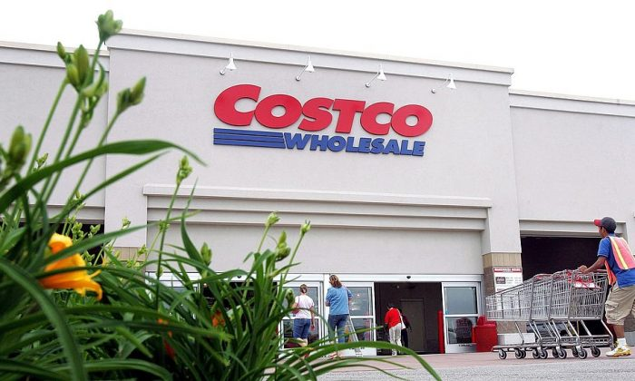 A worker pushes carts outside a Costco Wholesale store  in Mount Prospect, Illinois, on May 31, 2006. (Tim Boyle/Getty Images)