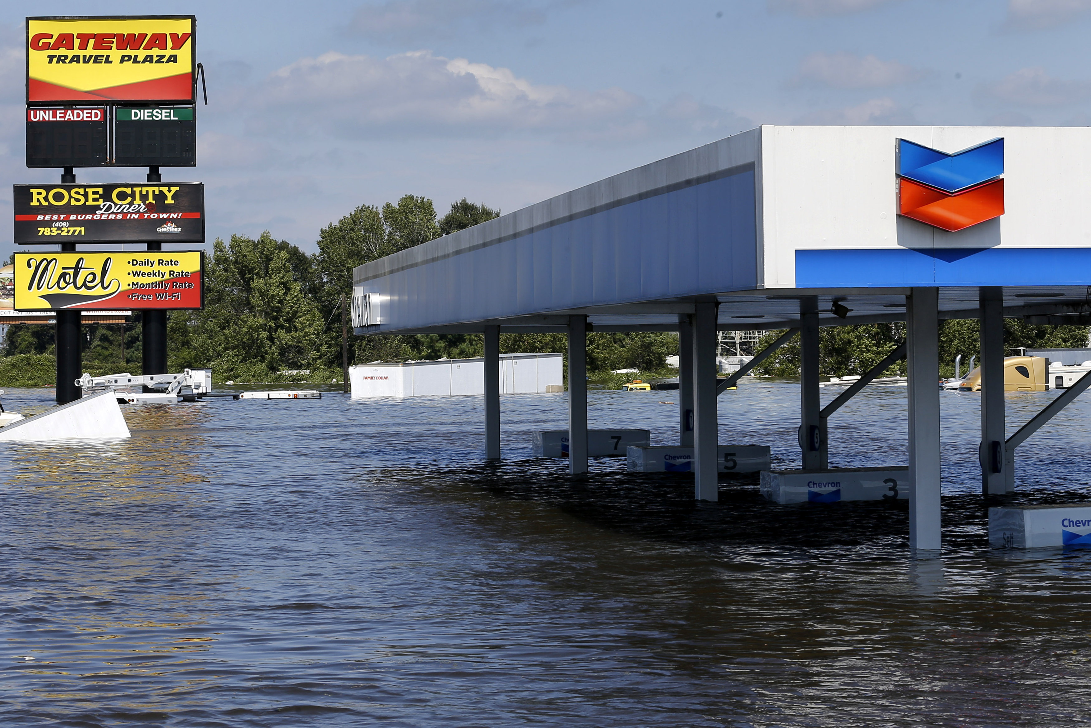 A gas station submerged under flood waters from Tropical Storm Harvey is seen in Rose City, Texas, U.S., on August 31, 2017. REUTERS/Jonathan Bachman