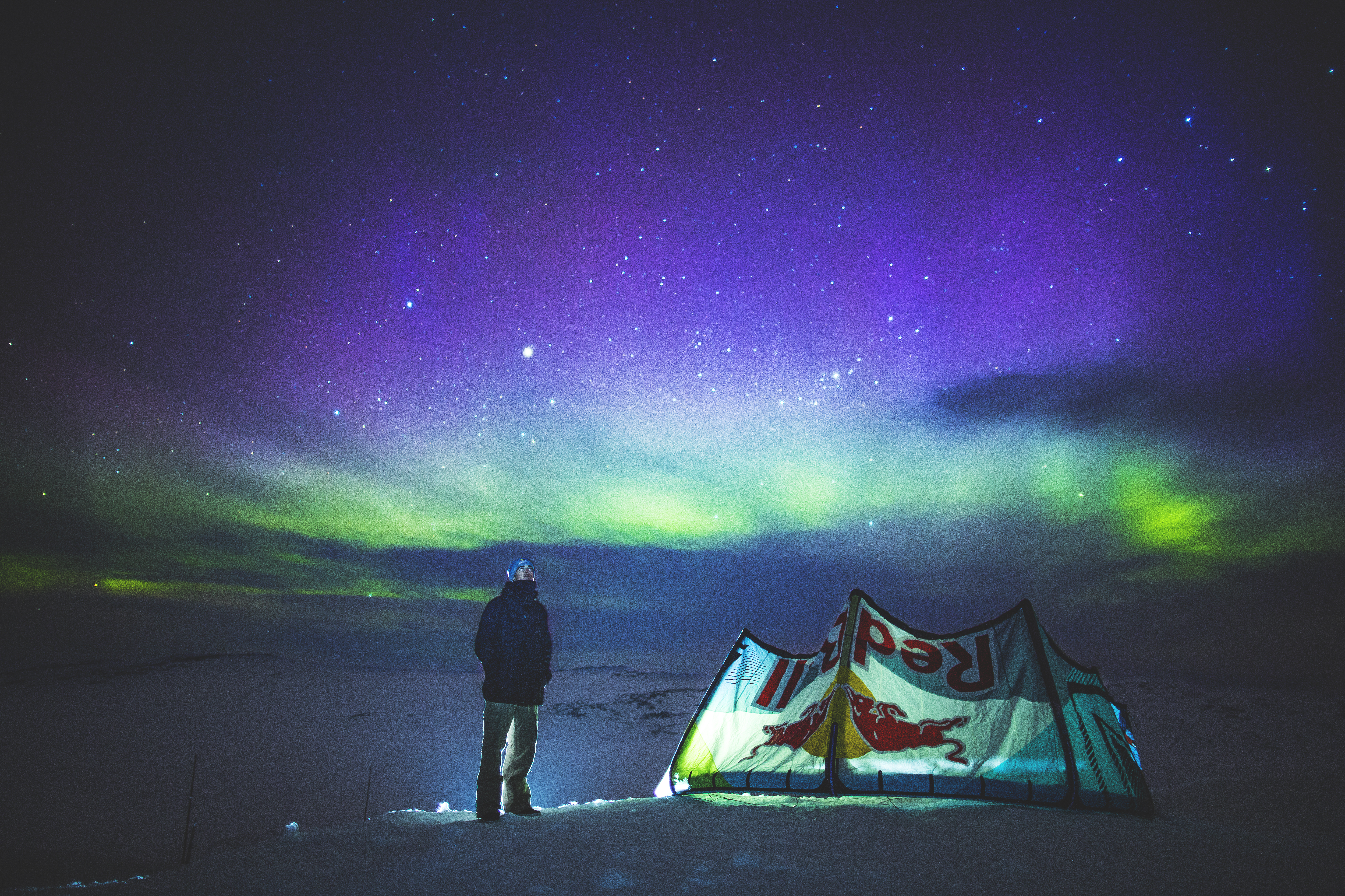 Christoph Tack watches the northern light during Red Bull Ragnarok at Hardangervidda in Haugastol , Norway on April 10, 2015. (Mats Grimsæth / Red Bull Content Pool)