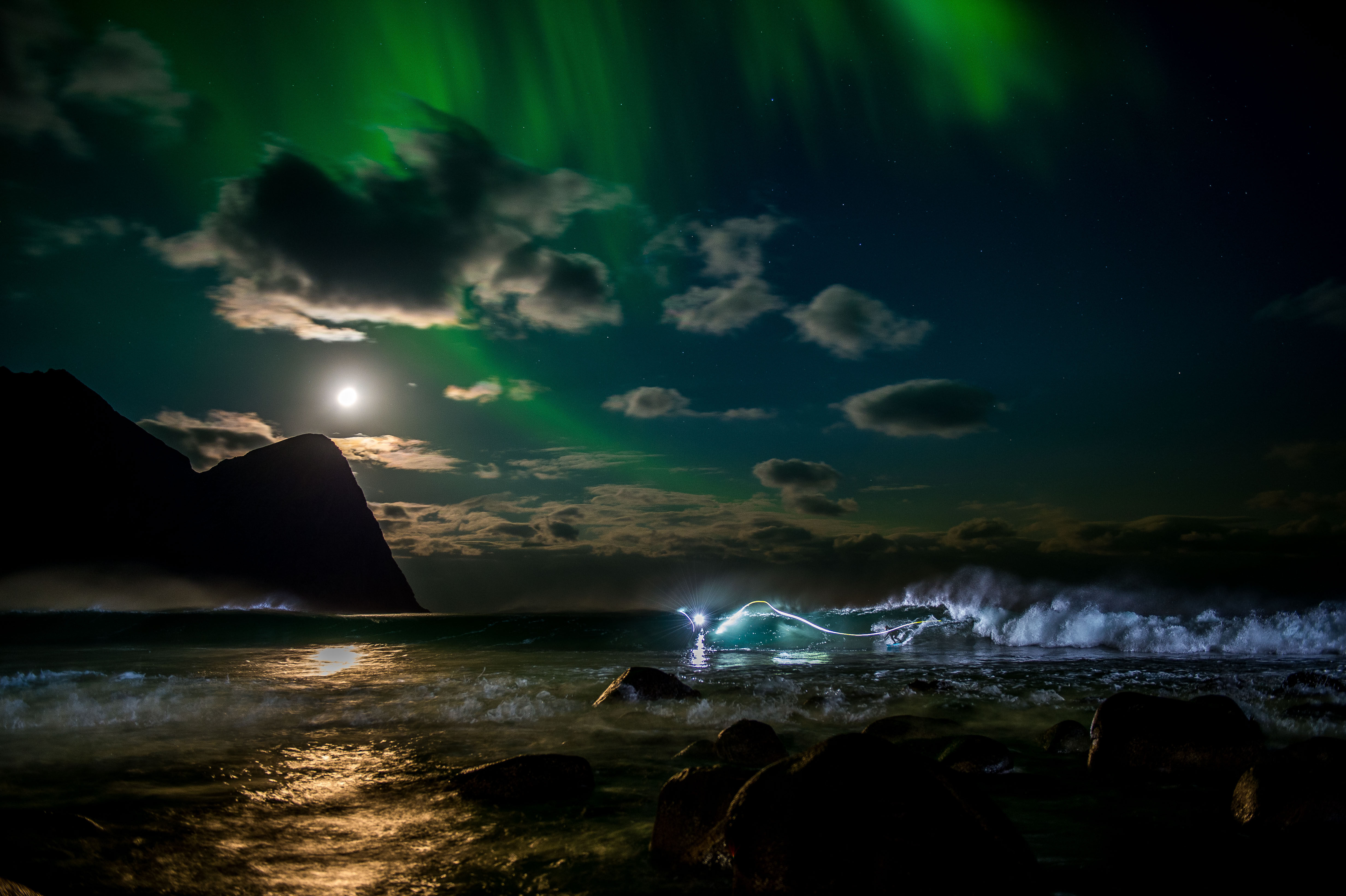 Mick Fanning is surfing in the colorful nights of Lofoten, Norway on Nov. 10, 2016. (Trevor Moran / Red Bull Content Pool)