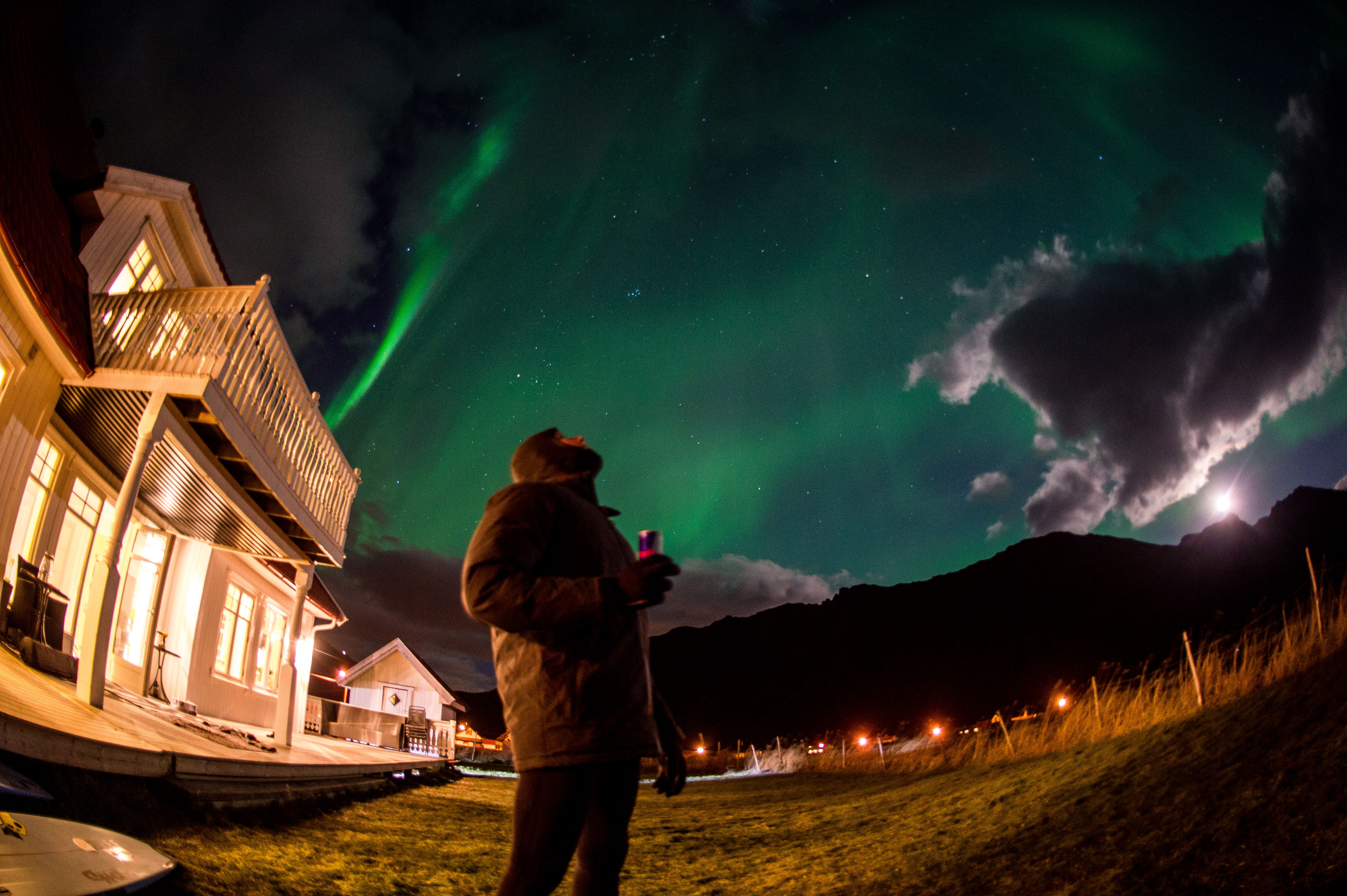 Mick Fanning is looking into the colorful night in Lofoten, Norway on Nov. 10, 2016.  (Trevor Moran / Red Bull Content Pool)