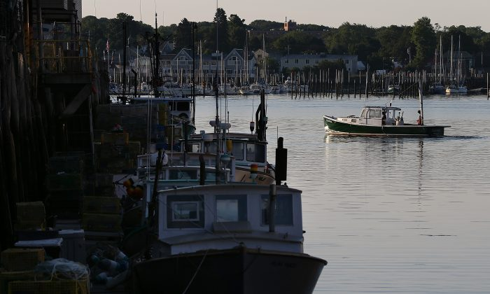 A fishing boat leaves the dock on July 21, 2012 in Portland, Maine. (Justin Sullivan/Getty Images)