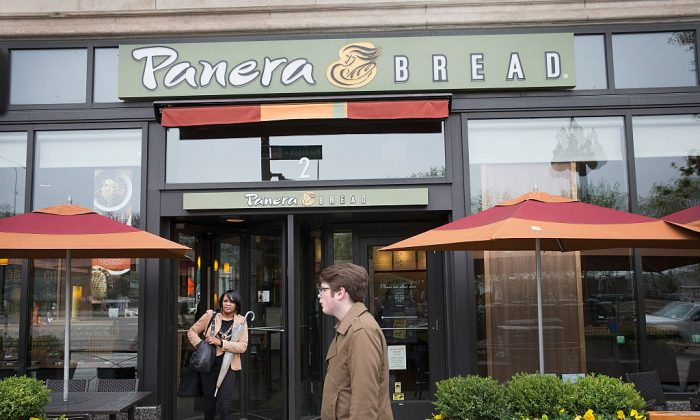 A sign marks the location of a Panera Bread restaurant on May 5, 2015 in Chicago, Illinois.  The company said today it has eliminated or intends to eliminate by the end of 2016 a list of more than 150 artificial colors, flavors, sweeteners and preservatives from food served in its U.S. restaurants.  (Photo by Scott Olson/Getty Images)