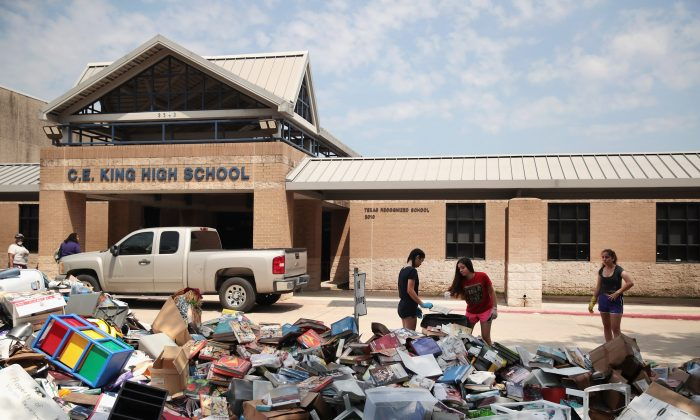 Volunteers and students from C.E. King High School help to clean up the school after torrential rains caused widespread flooding in the area during Hurricane and Tropical Storm Harvey on September 1, 2017 in Houston, Texas. (Scott Olson/Getty Images)