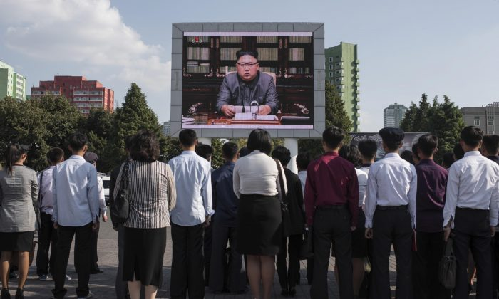 North Koreans watch a statement delivered by dictator Kim Jong Un on a television screen outside of the railway station in Pyongyang on Sept. 22, 2017. (ED JONES/AFP/Getty Images)