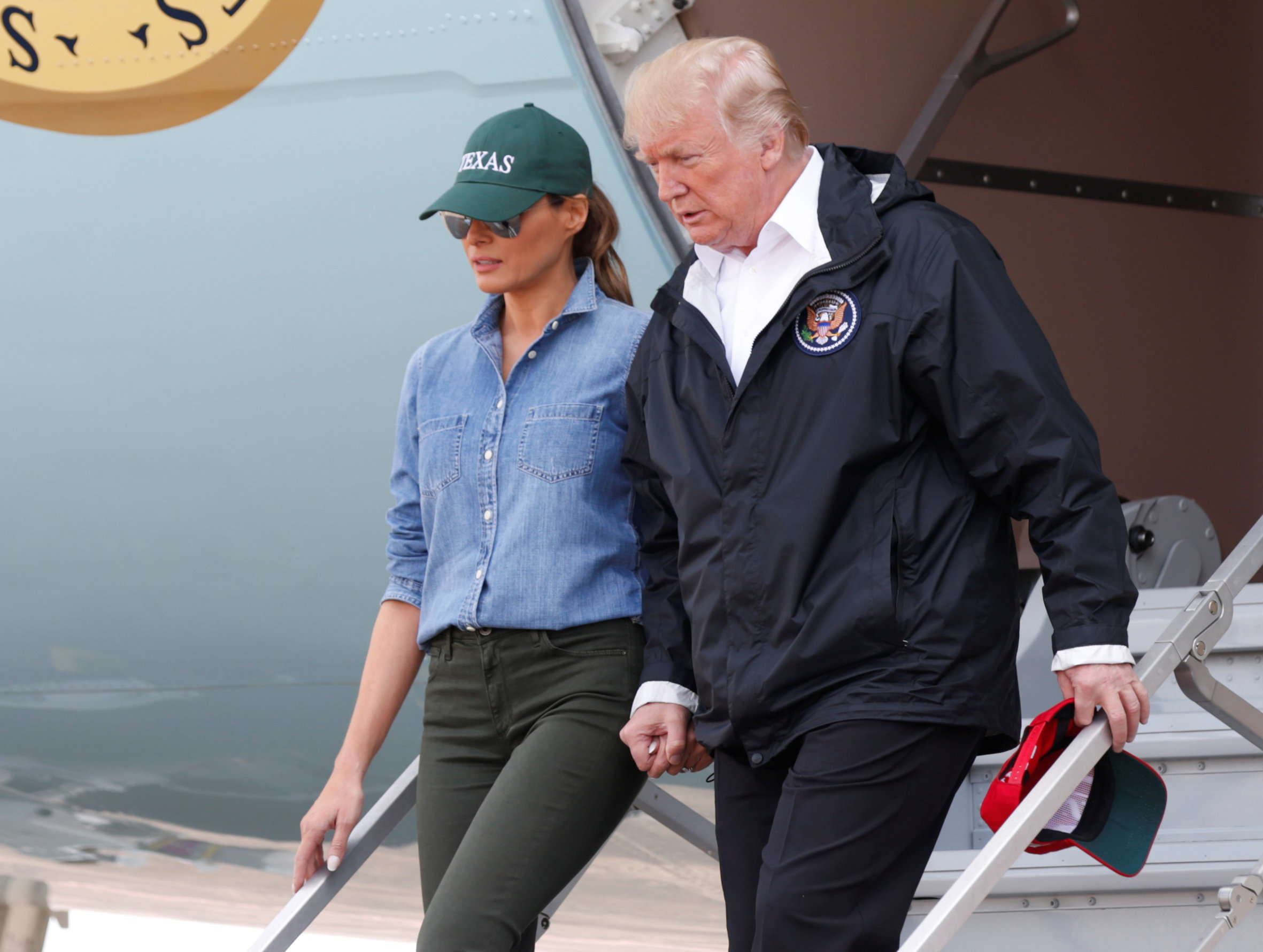 U.S. President Donald Trump and first lady Melania Trump deplane after arriving at Ellington Field to meet with flood survivors and volunteers who assisted in relief efforts in the aftermath of Hurricane Harvey, in Houston, Texas, U.S., September 2, 2017.   REUTERS/Kevin Lamarque