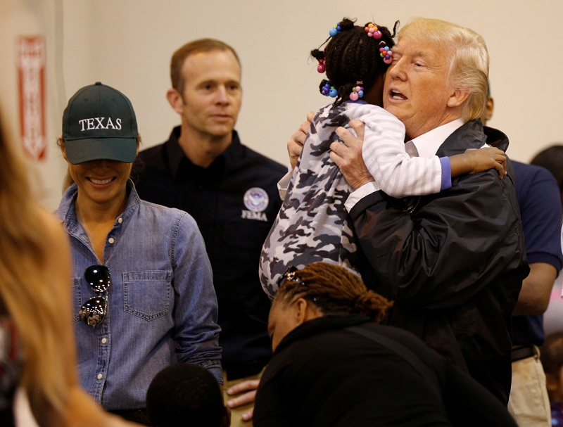 President Donald Trump and first lady Melania Trump greet children at the NRG Center where they met with flood survivors of Hurricane Harvey, in Houston, Texas on Sept. 2, 2017. (REUTERS/Kevin Lamarque)