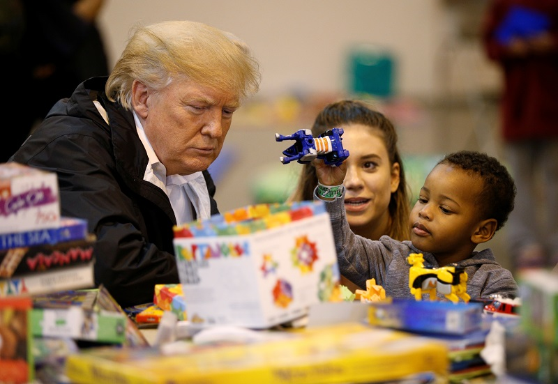 President Donald Trump visits with survivors of Hurricane Harvey at a relief center in Houston, Texas on Sept. 2, 2017. (REUTERS/Kevin Lamarque)