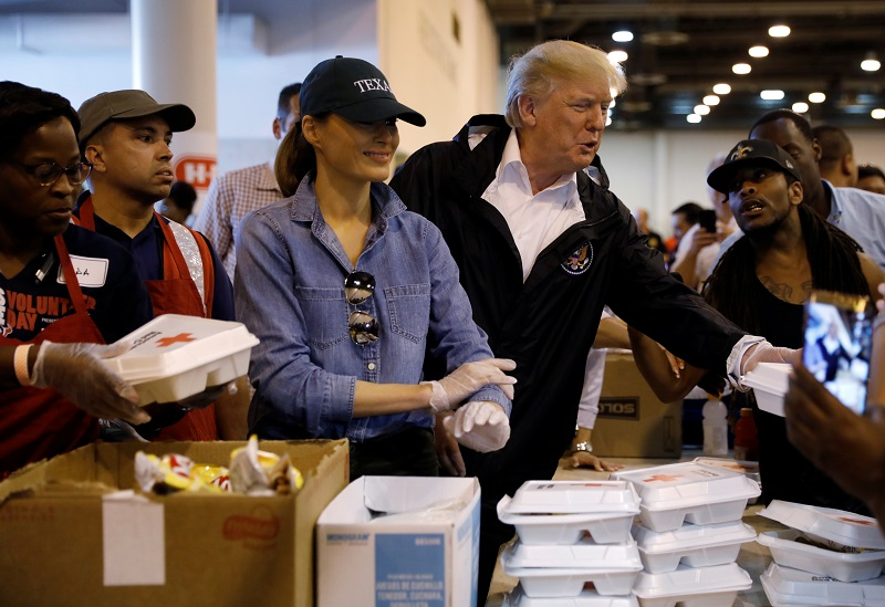 President Donald Trump and first lady Melania Trump help volunteers hand out meals during a visit with flood survivors of Hurricane Harvey at a relief center in Houston, Texas on Sept. 2, 2017.   (REUTERS/Kevin Lamarque)