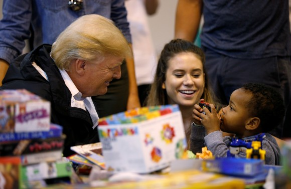 President Donald Trump visits with survivors of Hurricane Harvey at a relief center in Houston, Texas, on Sept. 2, 2017. (REUTERS/Kevin Lamarque)