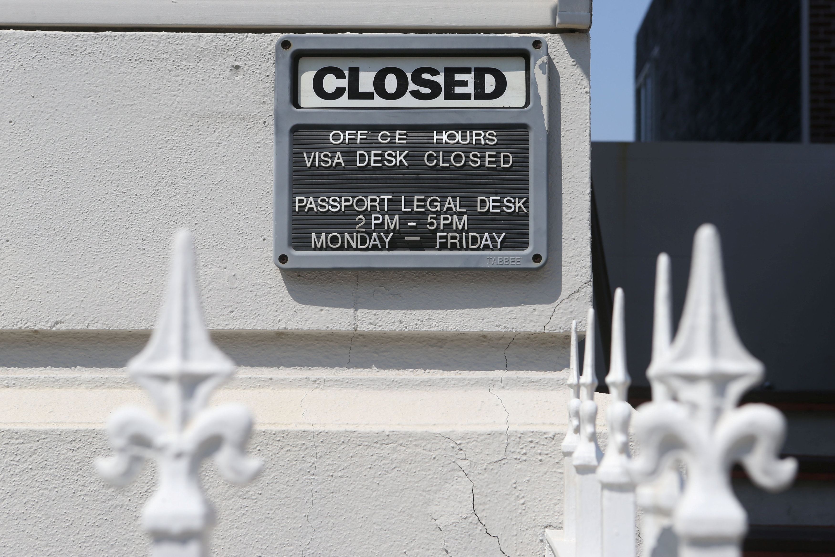 A Closed sign is seen on the Russian Consulate building, where smoke was seen earlier coming from its roof, in San Francisco, Calif., on Sept. 1, 2017. (REUTERS/Beck Diefenbach)
