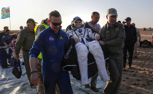 Ground personnel carry member of the International Space Station (ISS) crew Peggy Annette Whitson of the U.S. after the landing of the Soyuz MS-04 capsule in a remote area outside the town of Dzhezkazgan (Zhezkazgan), Kazakhstan September 3, 2017. (Reuters/Sergei Ilnitsky/Pool)