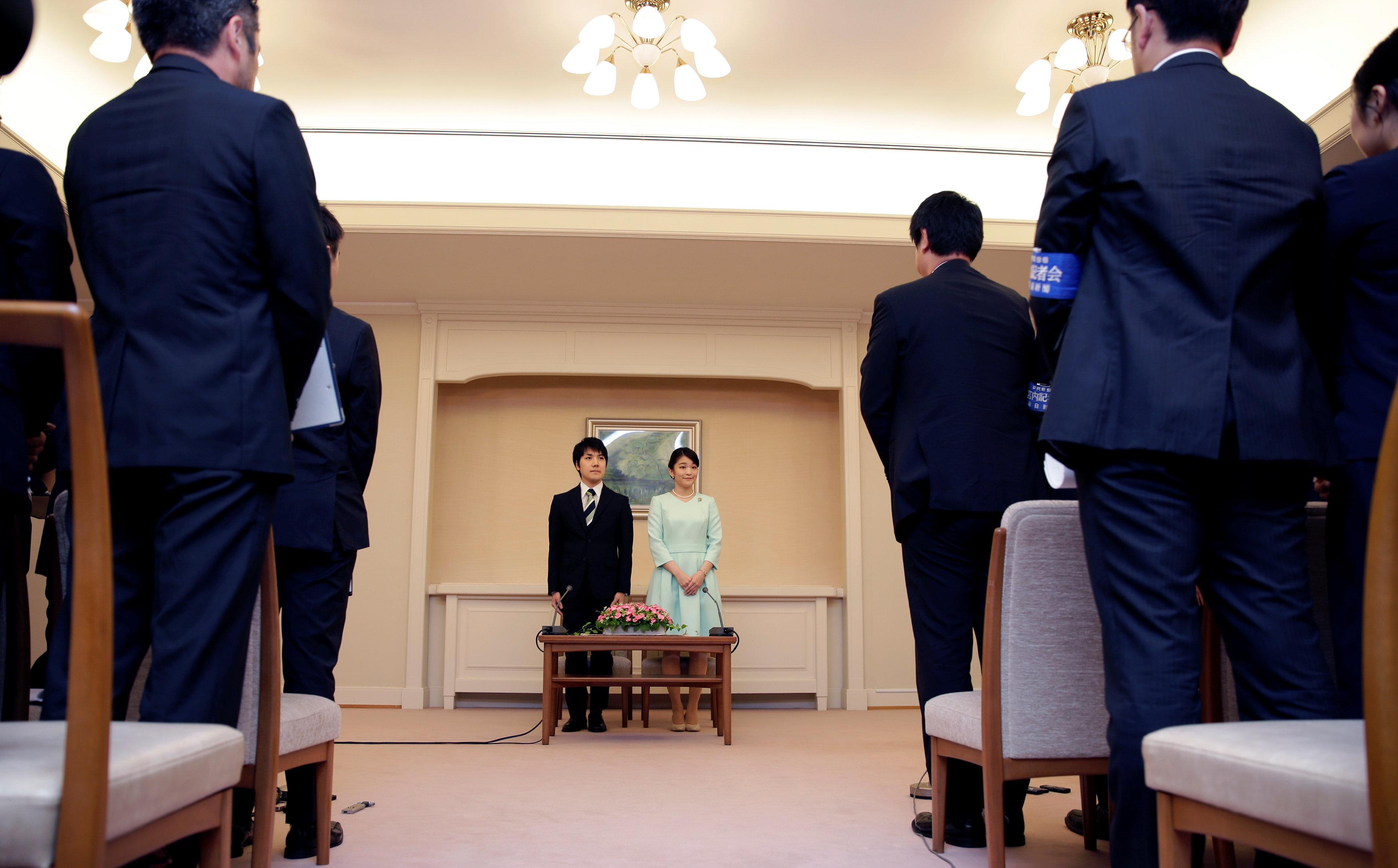Princess Mako, the elder daughter of Prince Akishino and Princess Kiko, and her fiancee Kei Komuro, a university friend of Princess Mako, stand during a press conference to announce their engagement at Akasaka East Residence in Tokyo, Japan on September 3, 2017. (REUTERS/Shizuo Kambayashi/Pool)