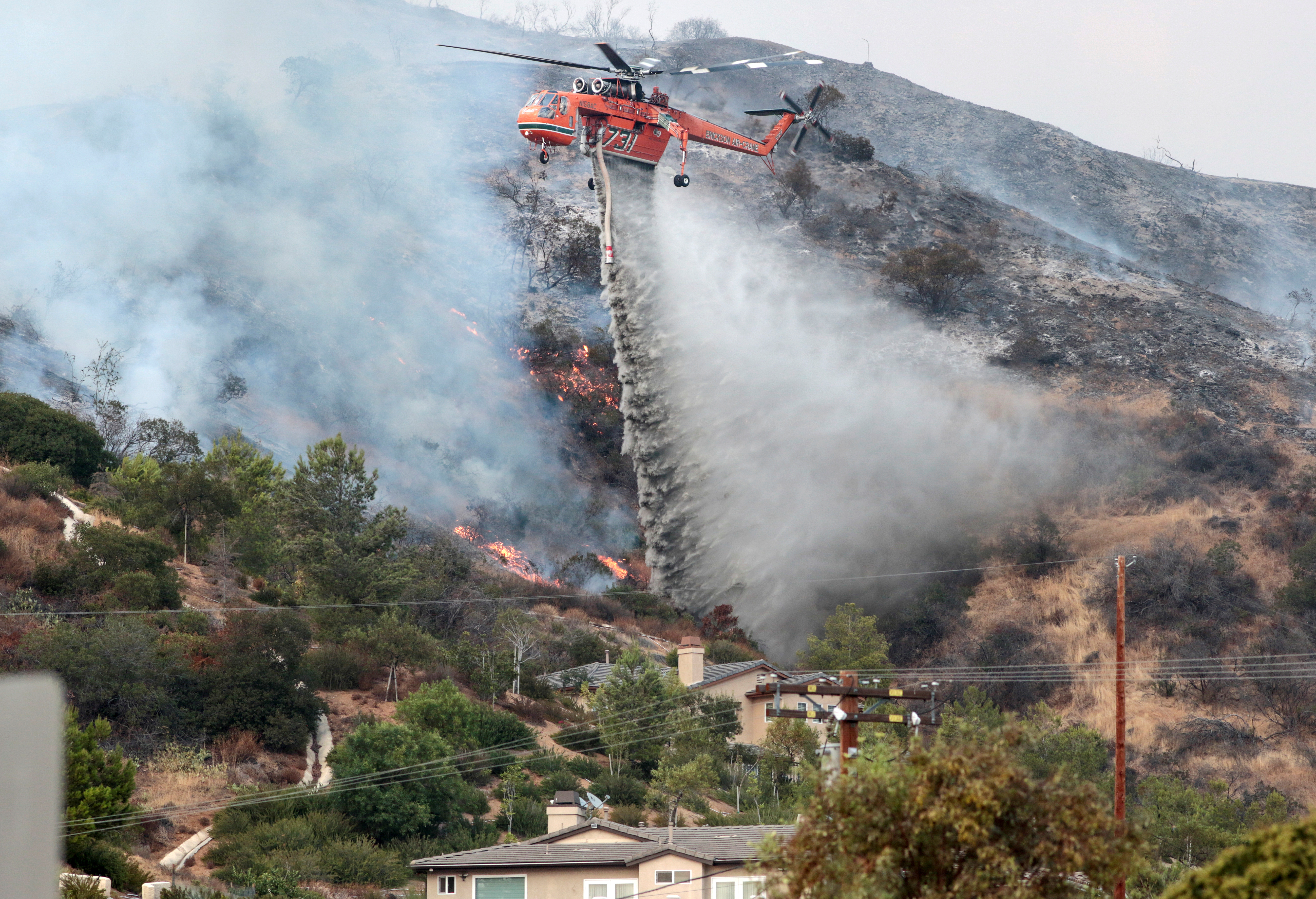 Water is dropped above homes in Sun Valley during the La Tuna Canyon fire over Burbank. (REUTERS/ Kyle Grillot)
