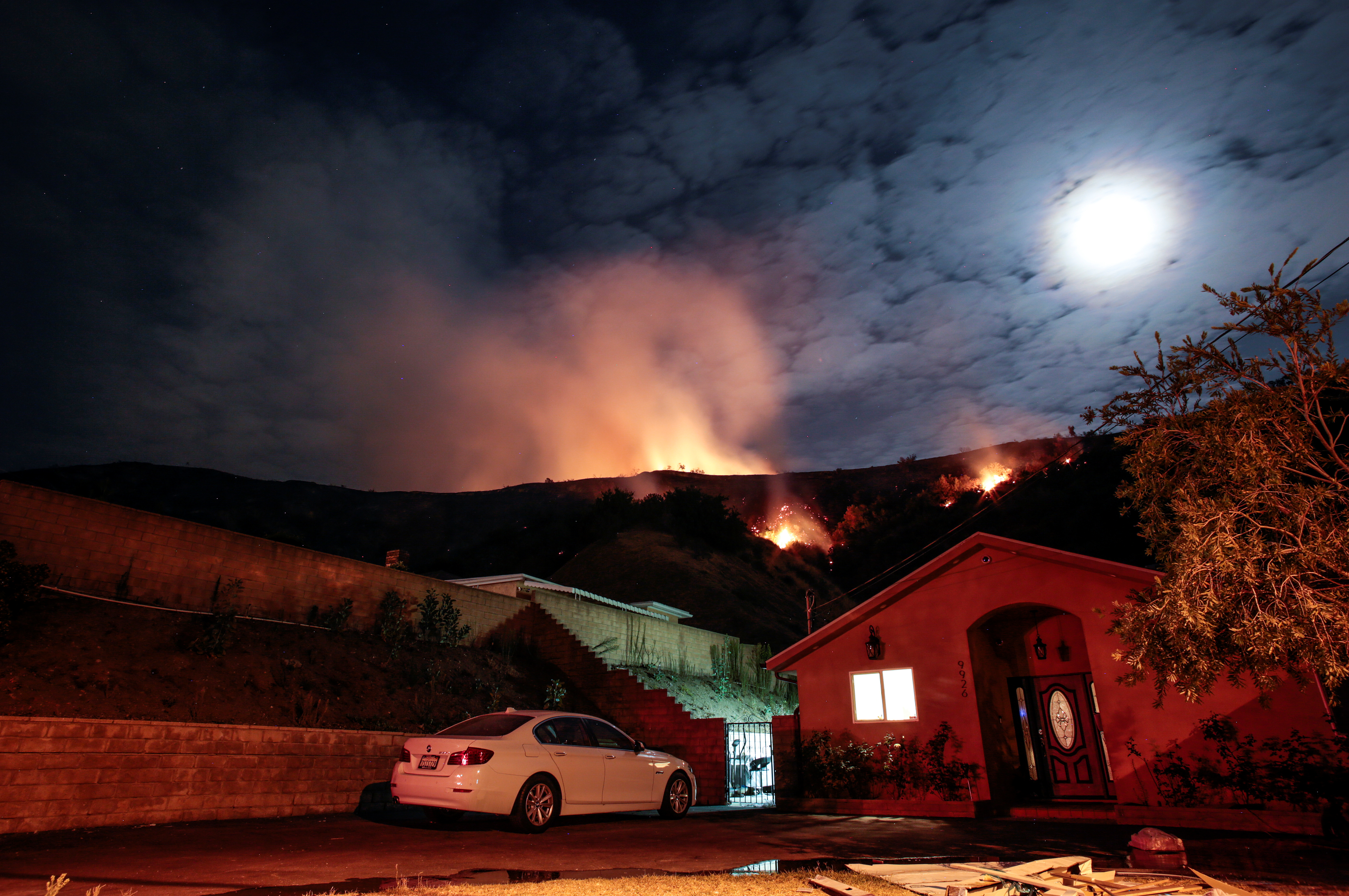 Flames rise over Sun Valley homes during the La Tuna Canyon fire over Burbank. (REUTERS/ Kyle Grillot)