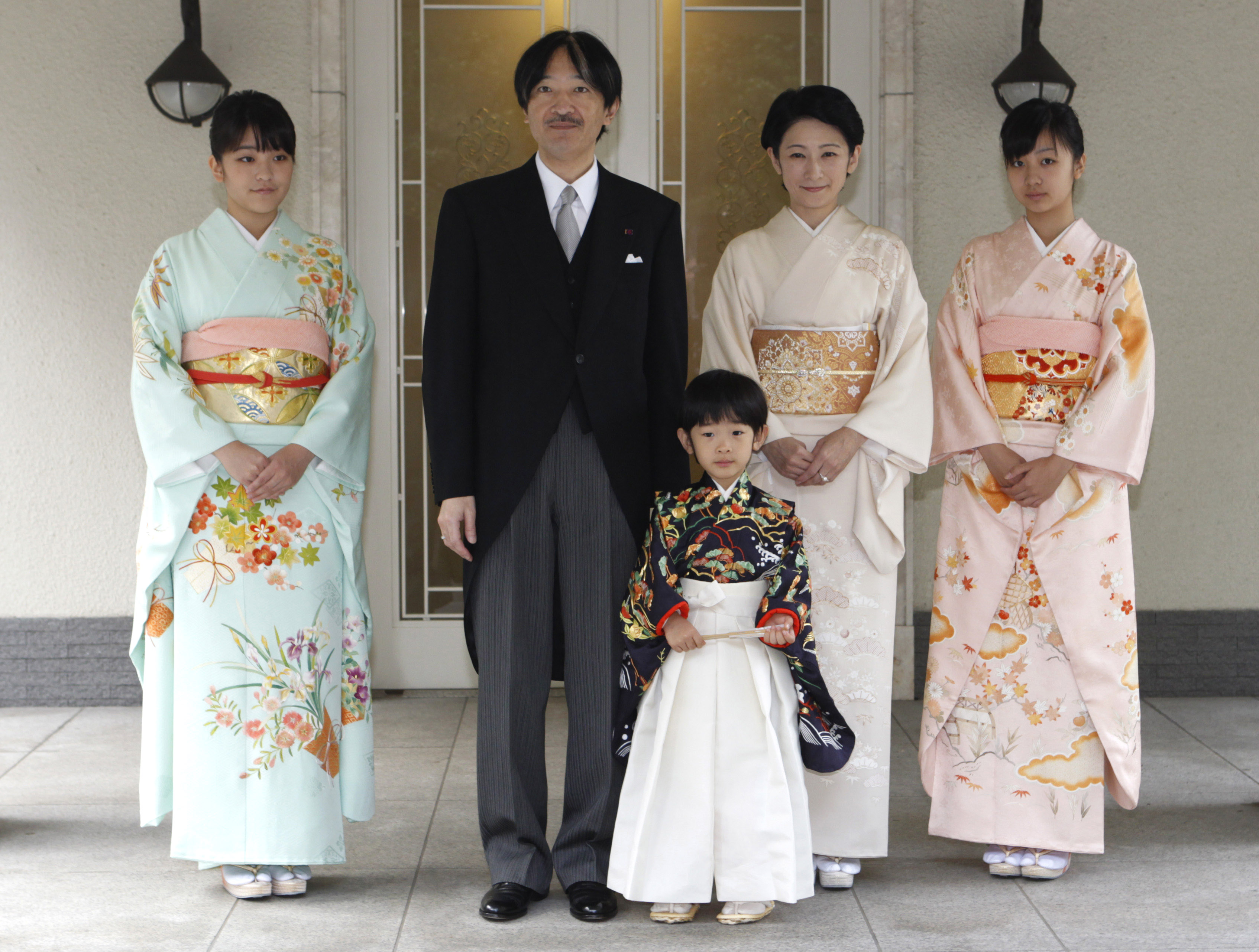 Japan's Prince Hisahito (C) wearing traditional ceremonial attire is accompanied by his father Prince Akishino (2nd L), mother Princess Kiko (centre R) and sisters Princess Mako (L) Princess Kako (R) after the Chakko-no-Gi and Fukasogi-no-gi ceremonies at the Akasaka imperial estate in Tokyo on Nov. 3, 2011. (ISSEI KATO/AFP/Getty Images)