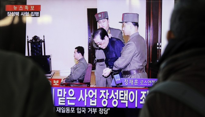 People watch television news showing Jang Song-thaek in court before his execution on Dec. 12, 2013, at the rail station in Seoul on December 13, 2013. (WOOHAE CHO/AFP/Getty Images)