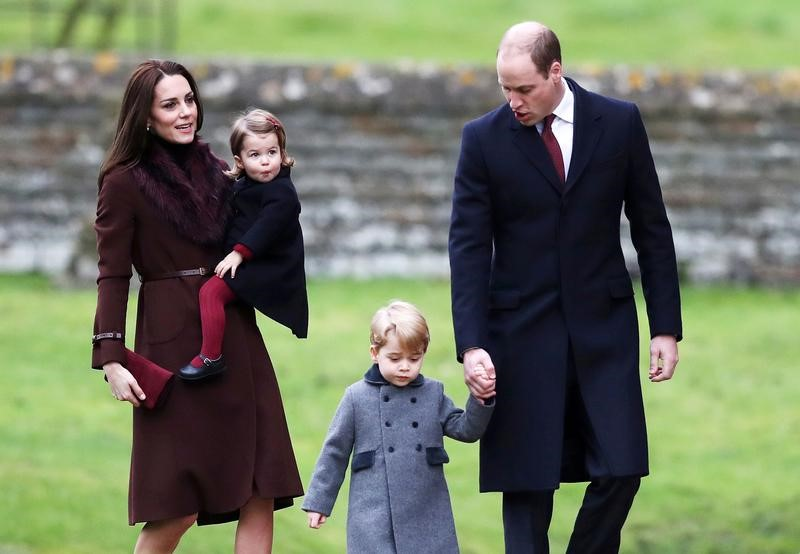 Prince William, the Duke of Cambridge (R), his wife Catherine, The Duchess of Cambridge (L), Prince George (2nd R) and Princess Charlotte arrive to attend the morning Christmas Day service at St Mark's Church in Englefield, near Bucklebury in southern England, Britain on Dec. 25, 2016. (REUTERS/Andrew Matthews/Pool)