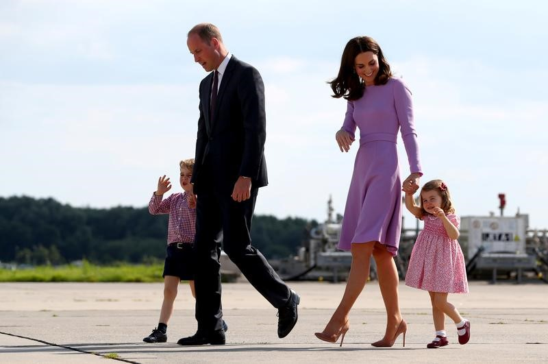 Britain's Prince William, the Duke of Cambridge, his wife Princess Kate, the Duchess of Cambridge, Prince George and Princess Charlotte walk at the airfield in Hamburg Finkenwerder, Germany, on July 21, 2017.    (REUTERS/Christian Charisius/POOL)