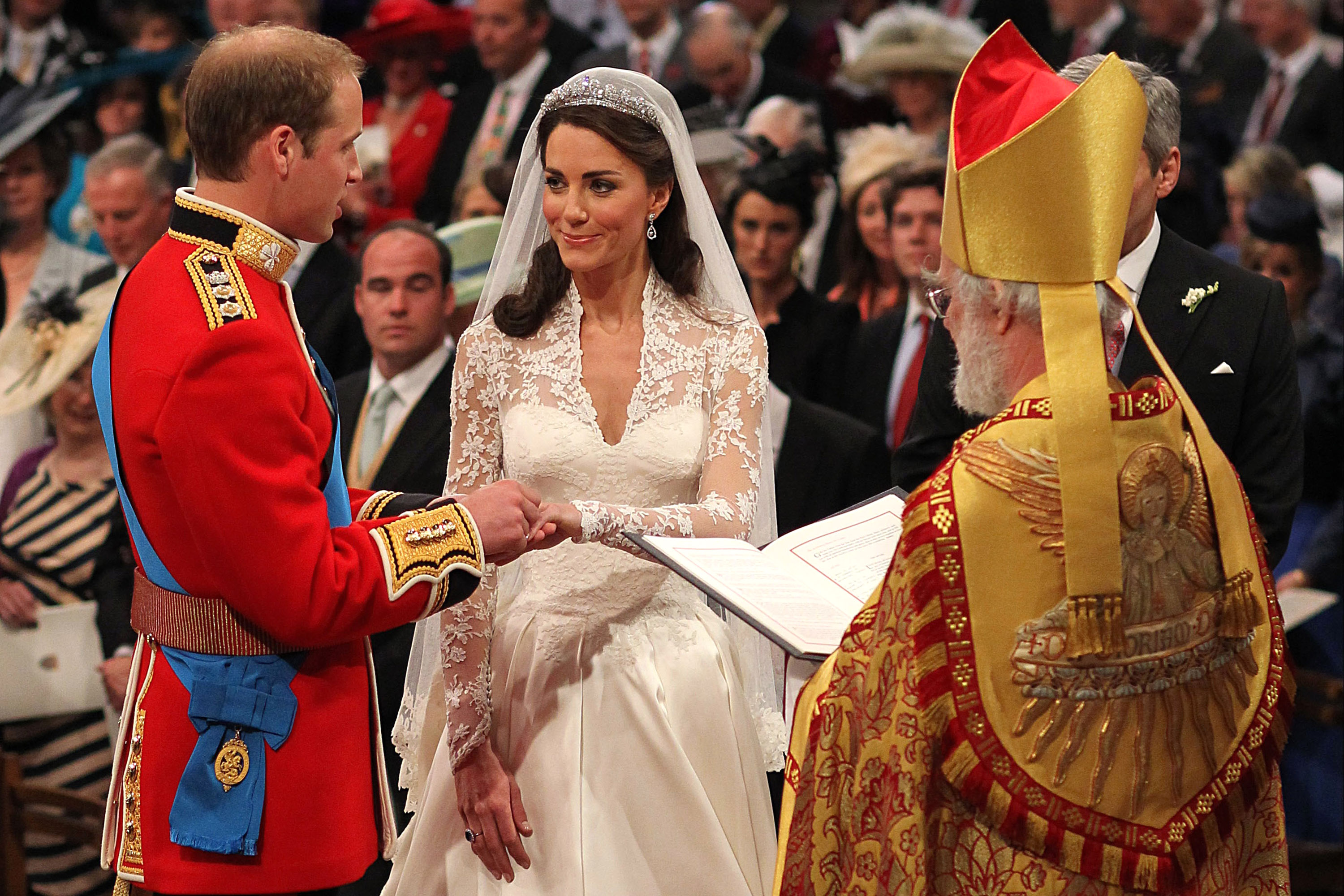 Prince William exchanges rings with his bride Catherine Middleton in front of the Archbishop of Canterbury Rowan Williams inside Westminster Abbey in London, England on April 29, 2011.    (Photo by Dominic Lipinski - WPA Pool/Getty Images)