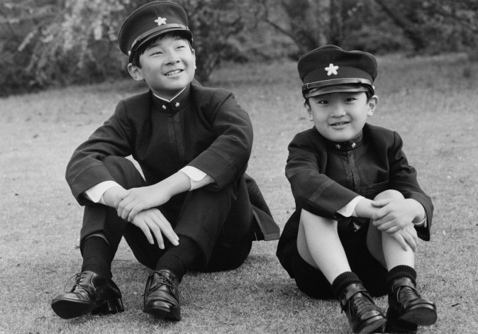 Prince Hiro (left), aka Crown Prince Naruhito of Japan, and his younger brother Prince Aya, aka Prince Akishino, wearing their new school uniforms in the grounds of Togu Palace, Tokyo, 9th April 1972. They have both started at the Gakushuin Junior High School in Tokyo. (Keystone/Hulton Archive/Getty Images)