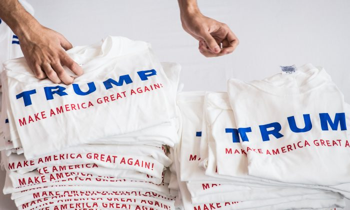 Volunteers pass out Donald Trump T-shirts at a campaign event September 23, 2015 in Columbia, South Carolina. (Sean Rayford/Getty Images)