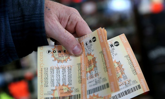 A customer holds a handful of Powerball tickets.  (Photo by Justin Sullivan/Getty Images)