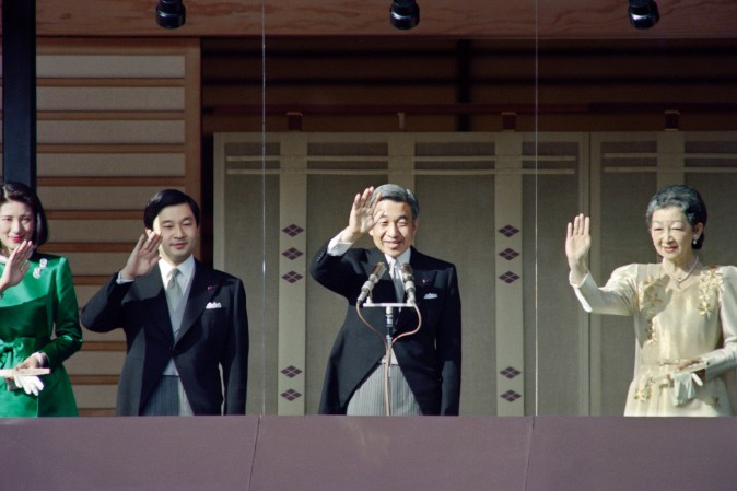 Japanese Emperor Akihito (2nd R), Empress Michiko (R), Prince Naruhito and Princess Masako (L) wave from a glass enclosed balcony of the Imperal Palace on January 2, 1994 while receiving New Year's greetings from some tens of thousands people. (TOSHIFUMI KITAMURA/AFP/Getty Images)