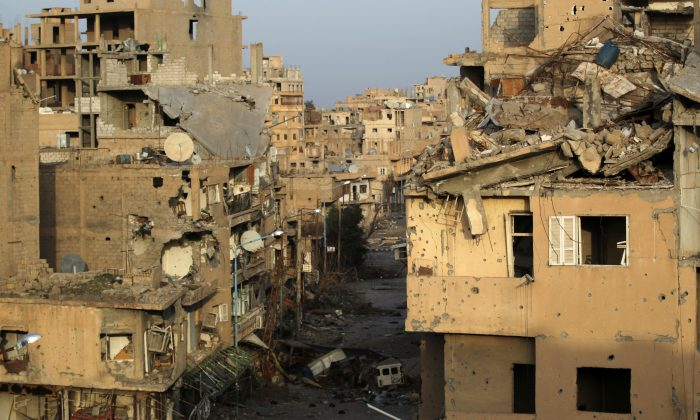 FILE PHOTO: A view shows damaged buildings in Deir al-Zor, eastern Syria February 19, 2014. (Reuters/Khalil Ashawi/File Photo)