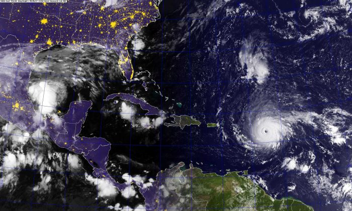 Hurricane Irma, a category 5 hurricane with maximum sustained winds near 185 mph with higher gusts, is shown in this GOES satellite image in the Atlantic Ocean east of the Leeward Islands and Puerto Rico and the Dominican Republic, on Sept. 5, 2017. (U.S. Navy photo/Handout via REUTERS)