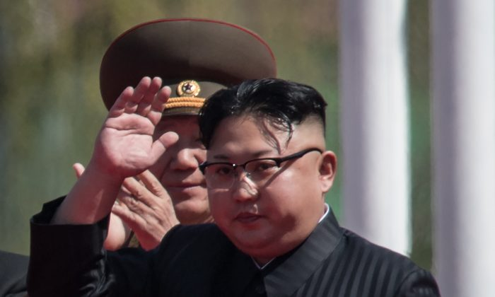 North Korean leader Kim Jong-Un waves during an opening ceremony for the 'Ryomyong street' housing development in Pyongyang on April 13, 2017. (ED JONES/AFP/Getty Images)