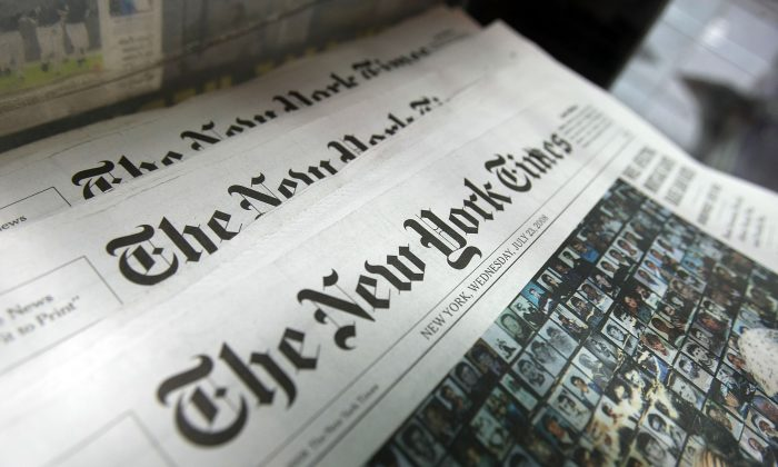 Copies of the New York Times sit for sale in a rack July 23, 2008 in New York City. (Mario Tama/Getty Images)