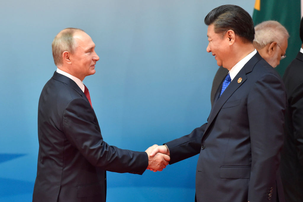 Chinese President Xi Jinping (R) and Russian President Vladimir Putin (L) shake hands before the group photo session at the Dialogue of Emerging Market and Developing Countries on the sidelines of the 2017 BRICS Summit in Xiamen, southeastern China's Fujian Province on September 5, 2017. Xi opened the annual summit of BRICS leaders that already has been upstaged by North Korea's latest nuclear weapons provocation. (KENZABURO FUKUHARA/AFP/Getty Images)