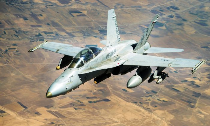 A Navy F-18 Growler flies over Syria in a mission supporting Operation Inherent Resolve to desroy ISIS, on Aug. 4. (Air Force photo/Staff Sgt. Trevor T. McBride)