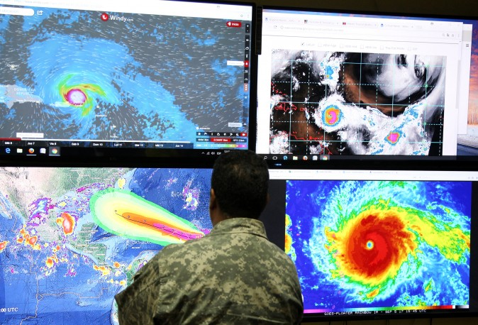 A member of the Emergency Operations Committee (COE) monitors the trajectory of Hurricane Irma in Santo Domingo, Dominican Republic on Sept. 5, 2017. (REUTERS/Ricardo Rojas)