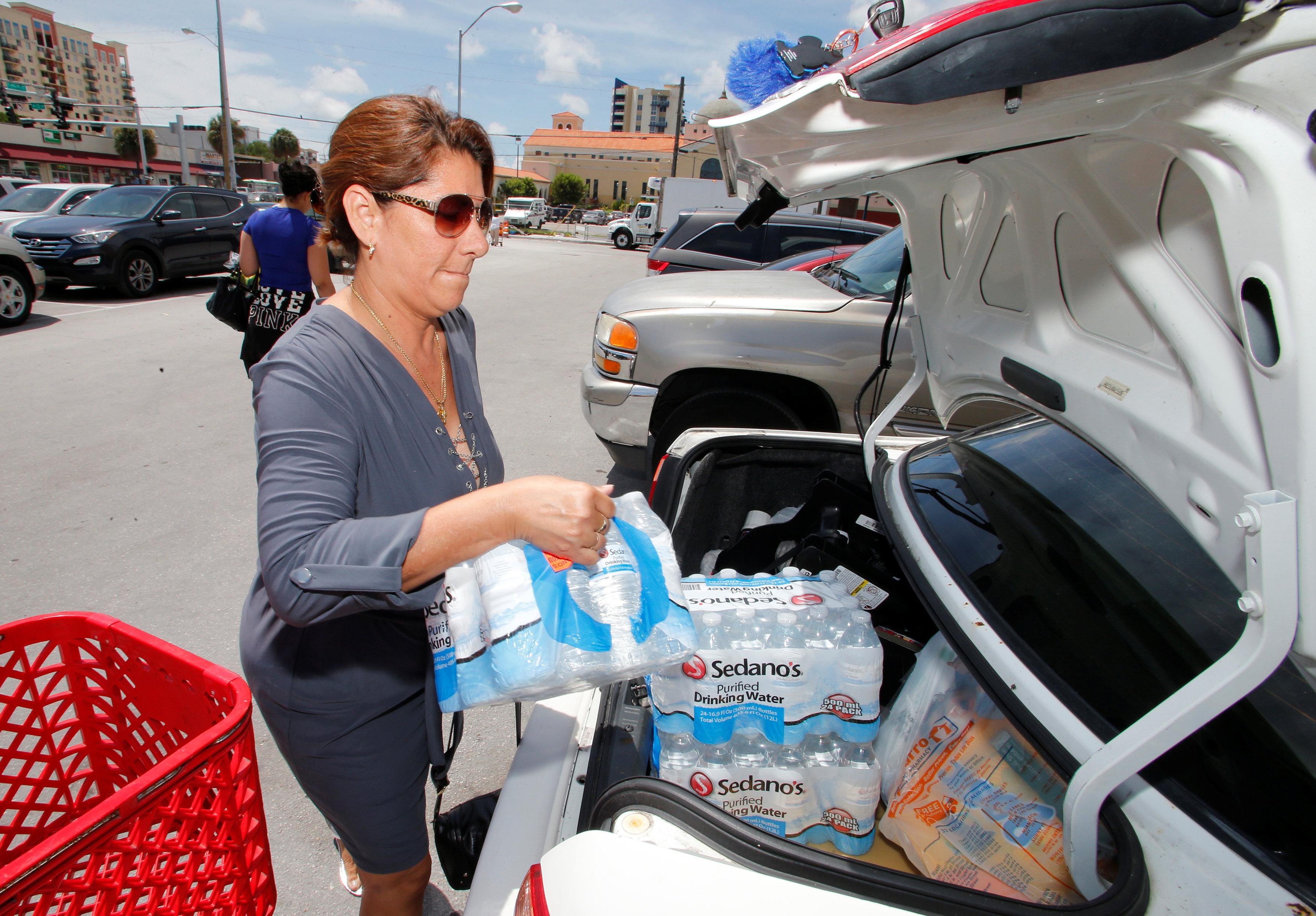 Ligia Marquez loads water she purchased in Sedano's Supermarket in the Little Havana neighborhood in Miami, Florida on Sept. 5, 2017. (REUTERS/Joe Skipper)