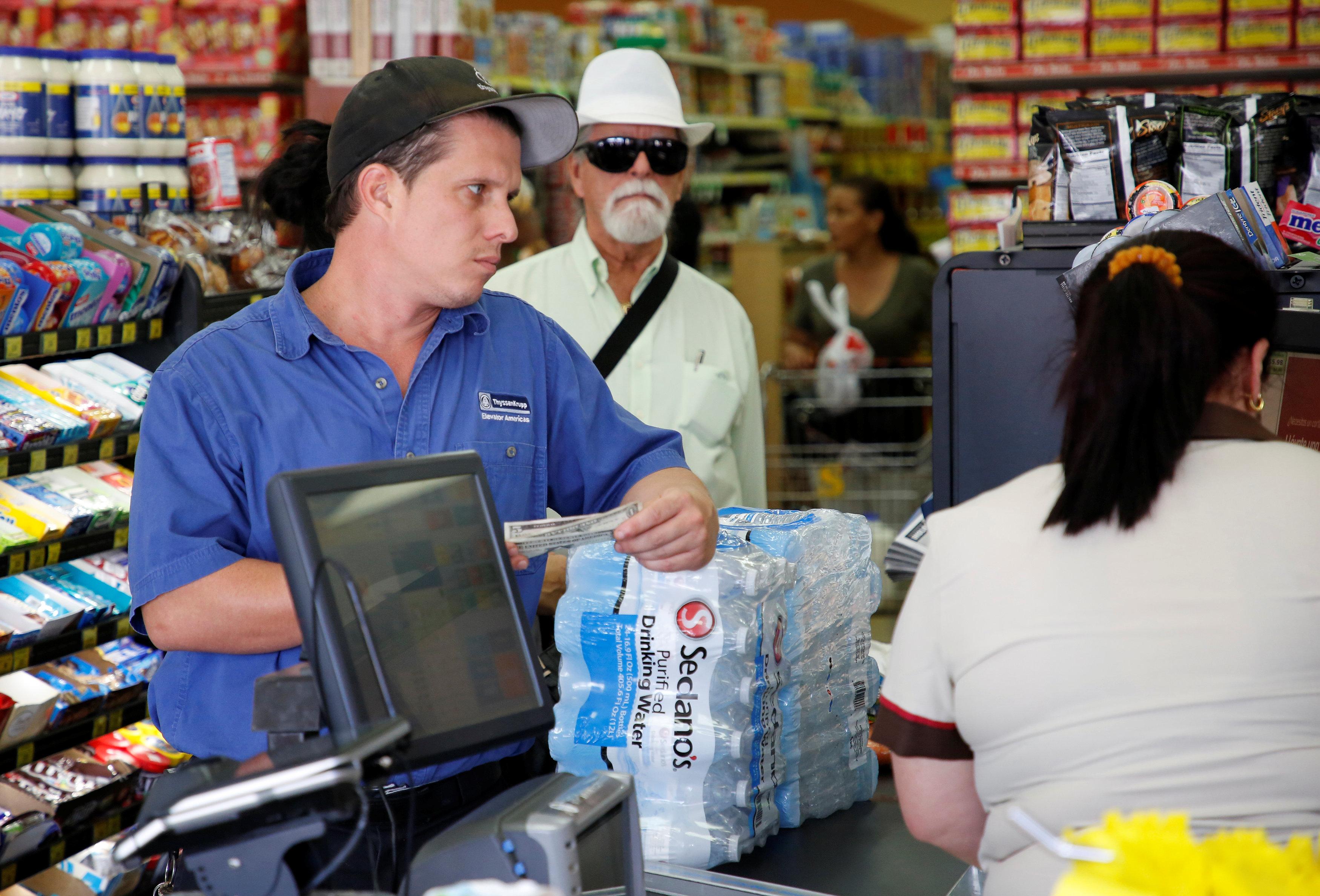 A shopper waits to purchase water in Sedano's Supermarket in the Little Havana neighborhood in Miami, Florida on Sept. 5, 2017.  (REUTERS/Joe Skipper)